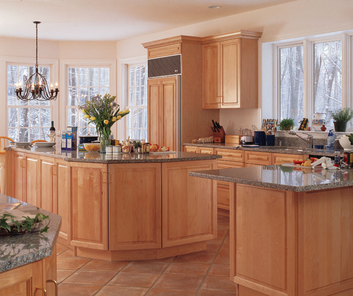 Light maple cabinets in kitchen by Kitchen Craft Cabinetry