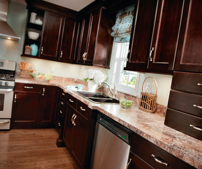 Alder cabinets in casual kitchen by Kitchen Craft Cabinetry