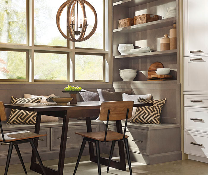 Dining area of a casual open kitchen design by Kitchen Craft Cabinetry