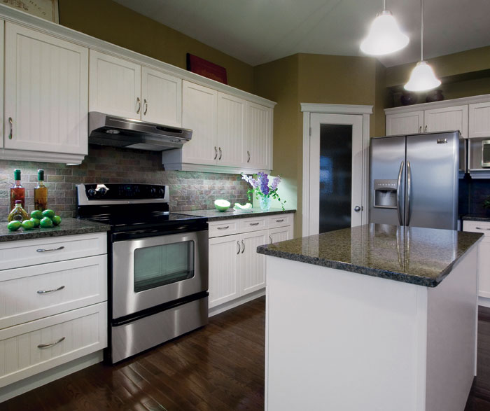 White kitchen cabinets with beadboard doors