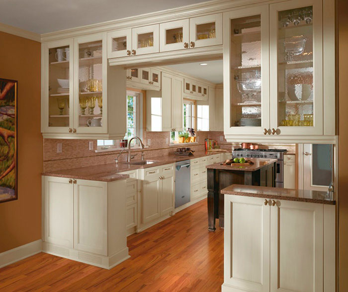 Off white cabinets in casual kitchen by Kitchen Craft Cabinetry