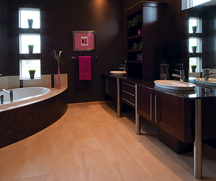 Contemporary bathroom cabinets in dark maple finish by Kitchen Craft Cabinetry