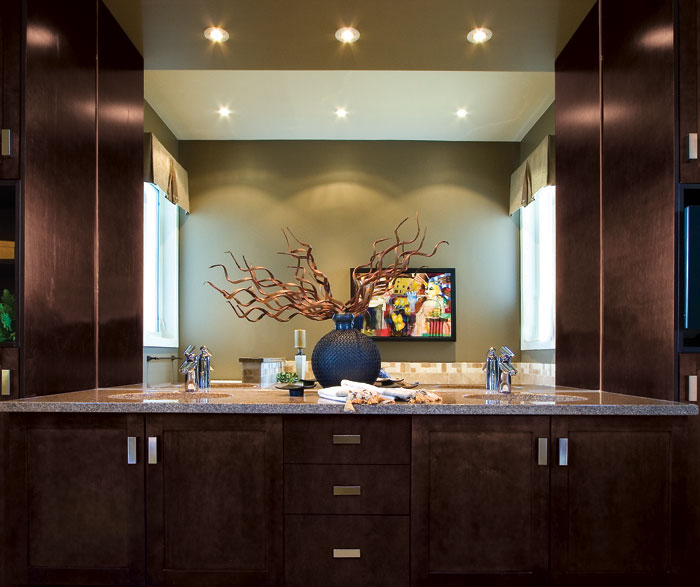 Espresso shaker cabinets in bathroom by Kitchen Craft Cabinetry