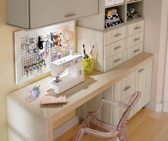 Craft room cabinets in thermofoil by Kitchen Craft Cabinetry